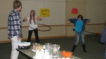 YAAC members Kira Woods and Katie Gerlt demonstrate how to Hula Hoop while Ethan Lindt spectates, just before the doors open for the Big Top Scavenger Hunt at the Central Library. March 15, 2012.