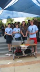 Library staff and YAAC members at Corona del Mar High School after the first Paperback Give-away event. Left to right: Mara Cota, Kelly Atherton, McKenzie Brown and Ethan Dean. 2010.