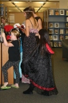YAAC members McKenzie Brown and Ethan Dean lead a team of younger children during the Spooky Scavenger Haunt, 2009, at the Central Library.